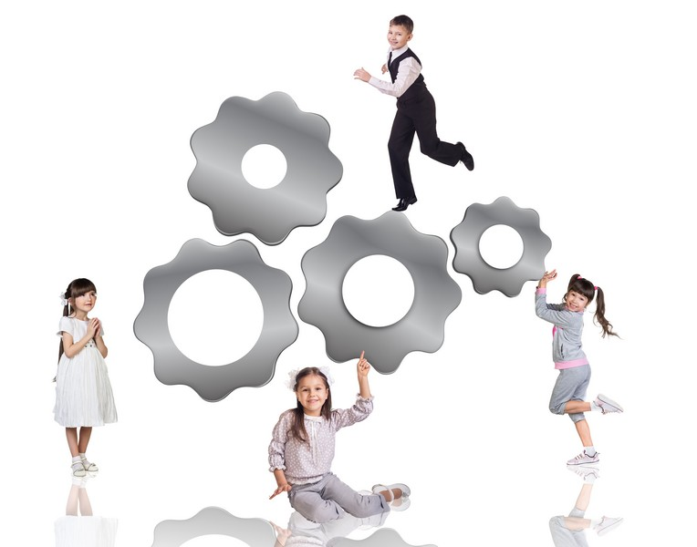 Children beside metal gears isolated on the white background